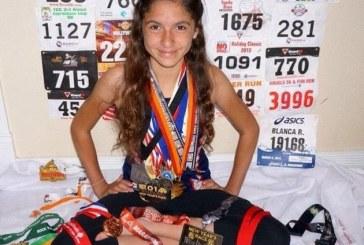 O fata de 12 ani a alergat 7 maratoane pe 5 continente