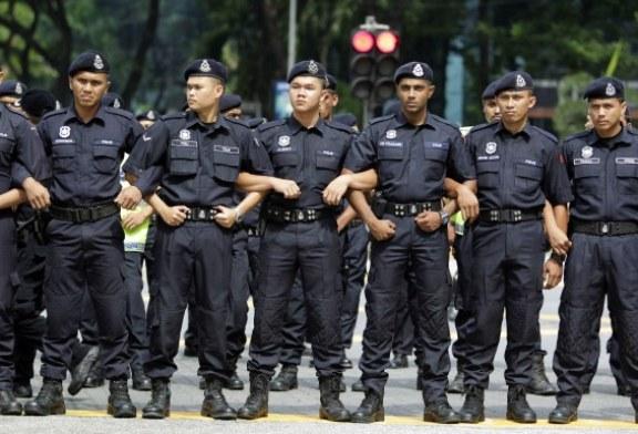 Politistii din Malayesia care vor sa promoveze trebuie sa slabeasca