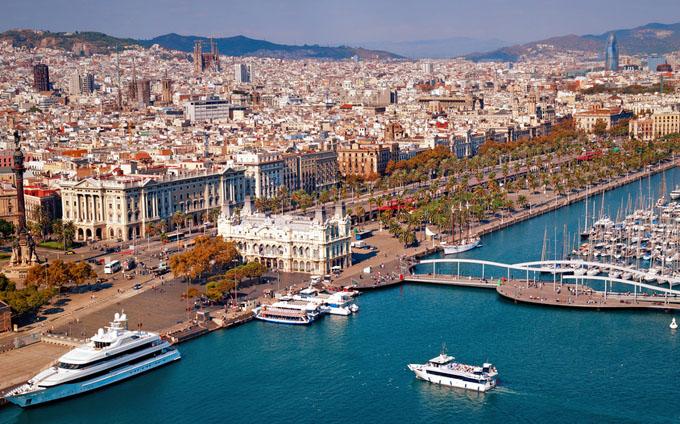Barcelona skyline, Sagrada Familia and Torre Agbar are  visible.