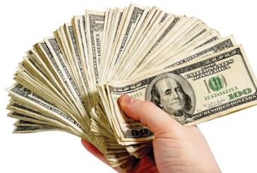 Dolarul a crescut cu 3,55 bani