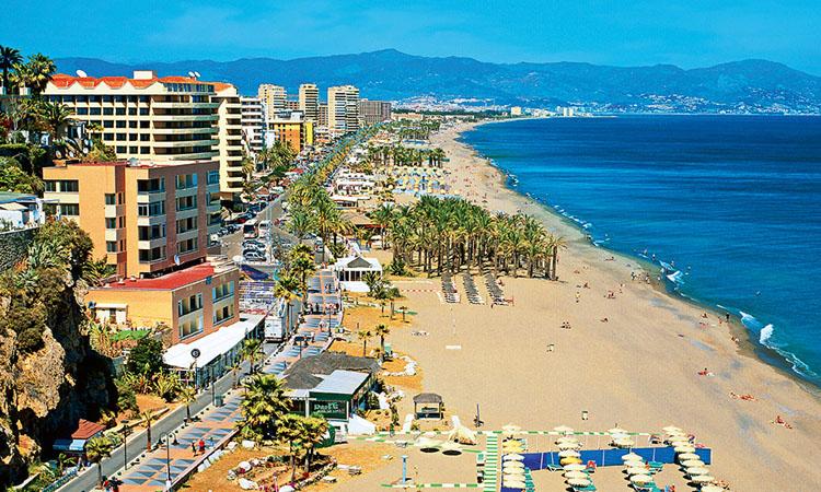 View along beach, Torremolinos, Costa del Sol, Andalucia, Spain,