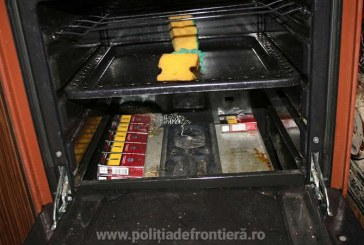 Descinderi la membrii unei retele specializate in contrabanda cu tigari